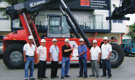 Julien Domingo (fifth from the left) DIPSSCOR Assistant General Manager, receives from Aristheo Ramos (forth from left) Portmizer Philippines Corporations' Director for Sales, a Certificate of Acceptance for the new Kalmar 45-tonner reach stacker.